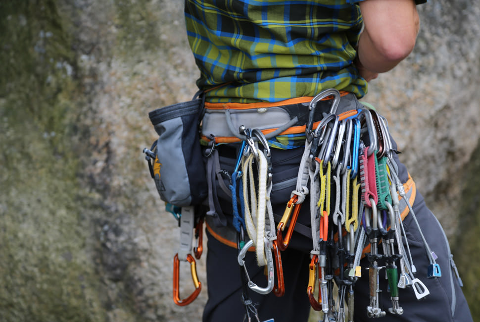person with climbing gear