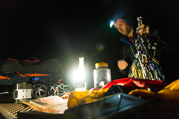 person setting up climbing gear