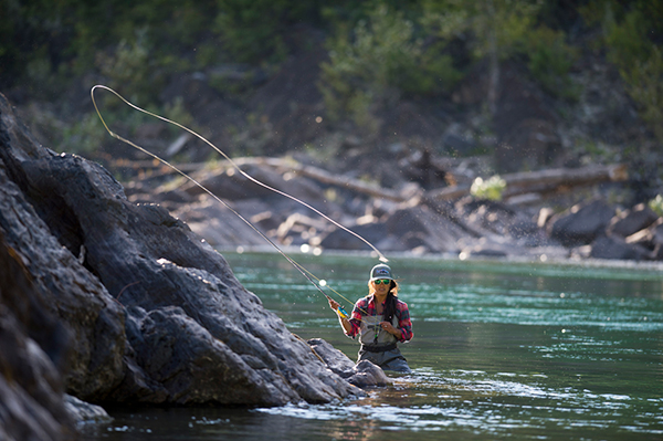 person fly fishing