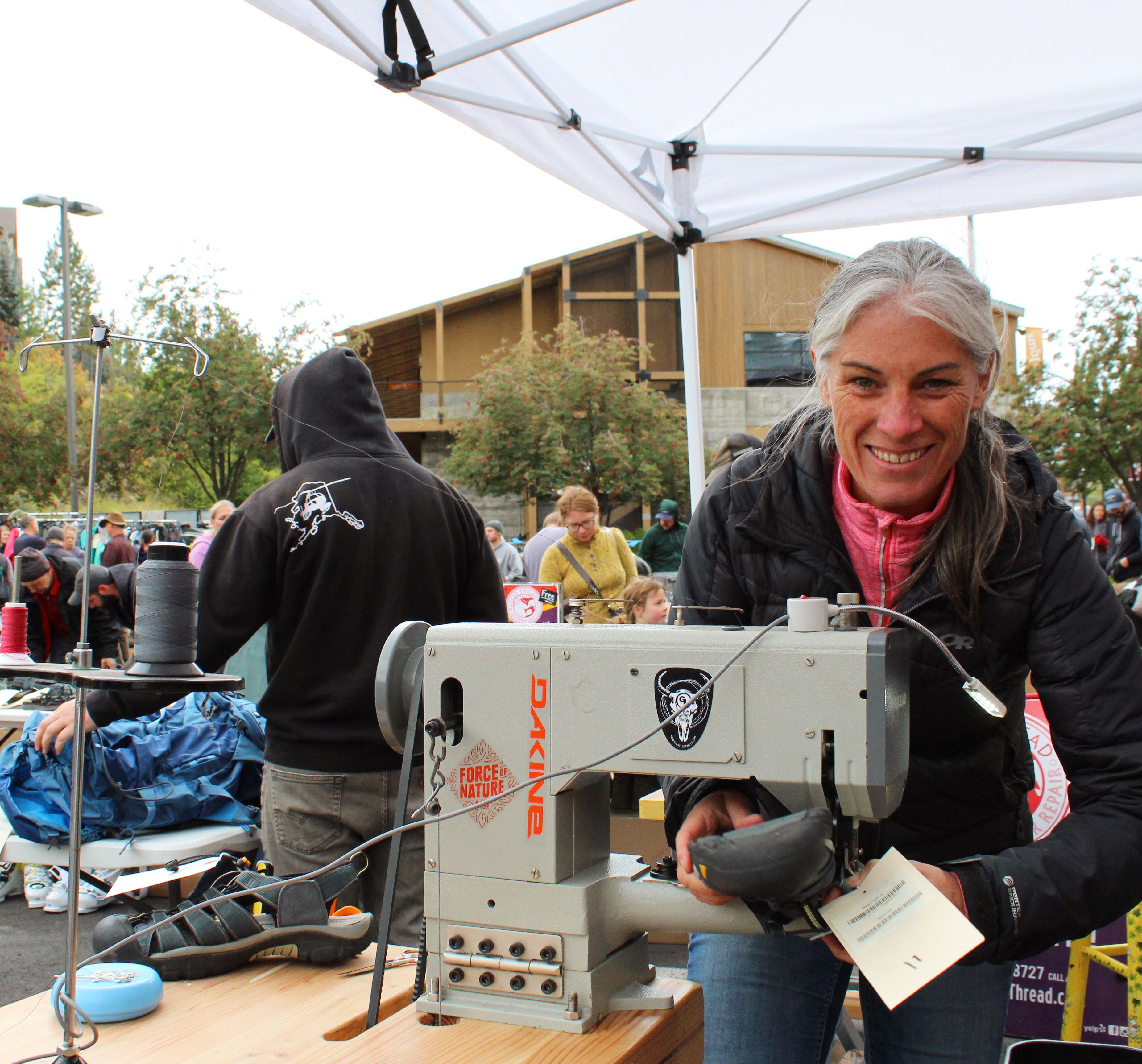 Kim Kinney Founder and CEO Rugged Thread at a mobile repair event