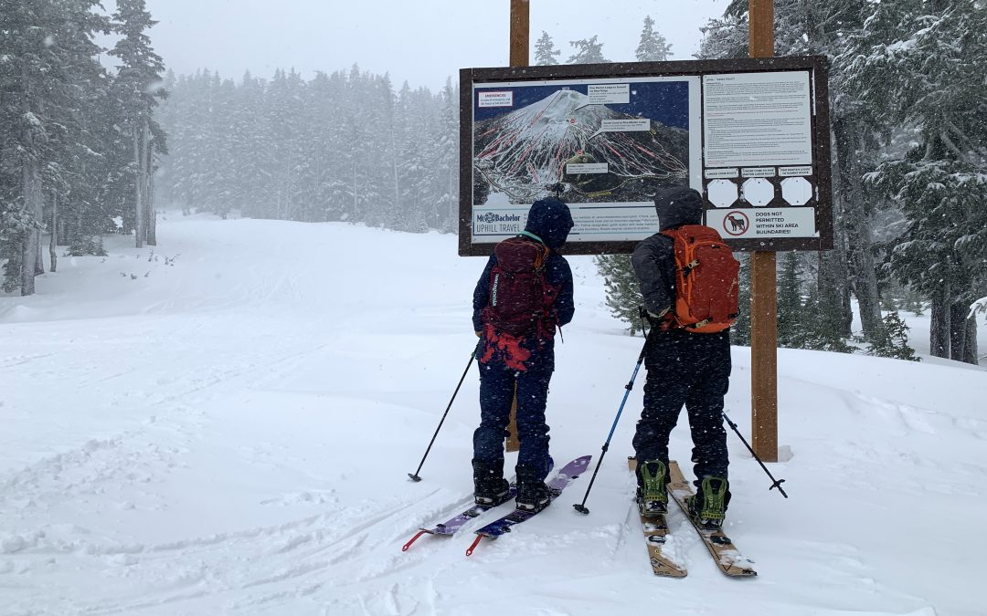people skiing looking at a map