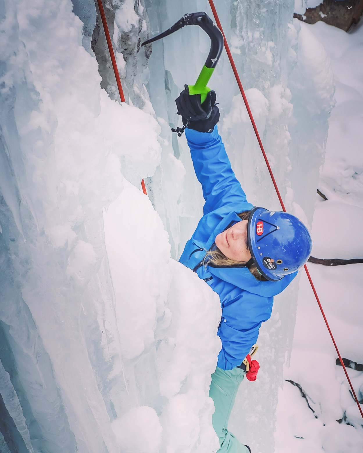 Author Beth Lopez demonstrating ice tools needed for ice climbing