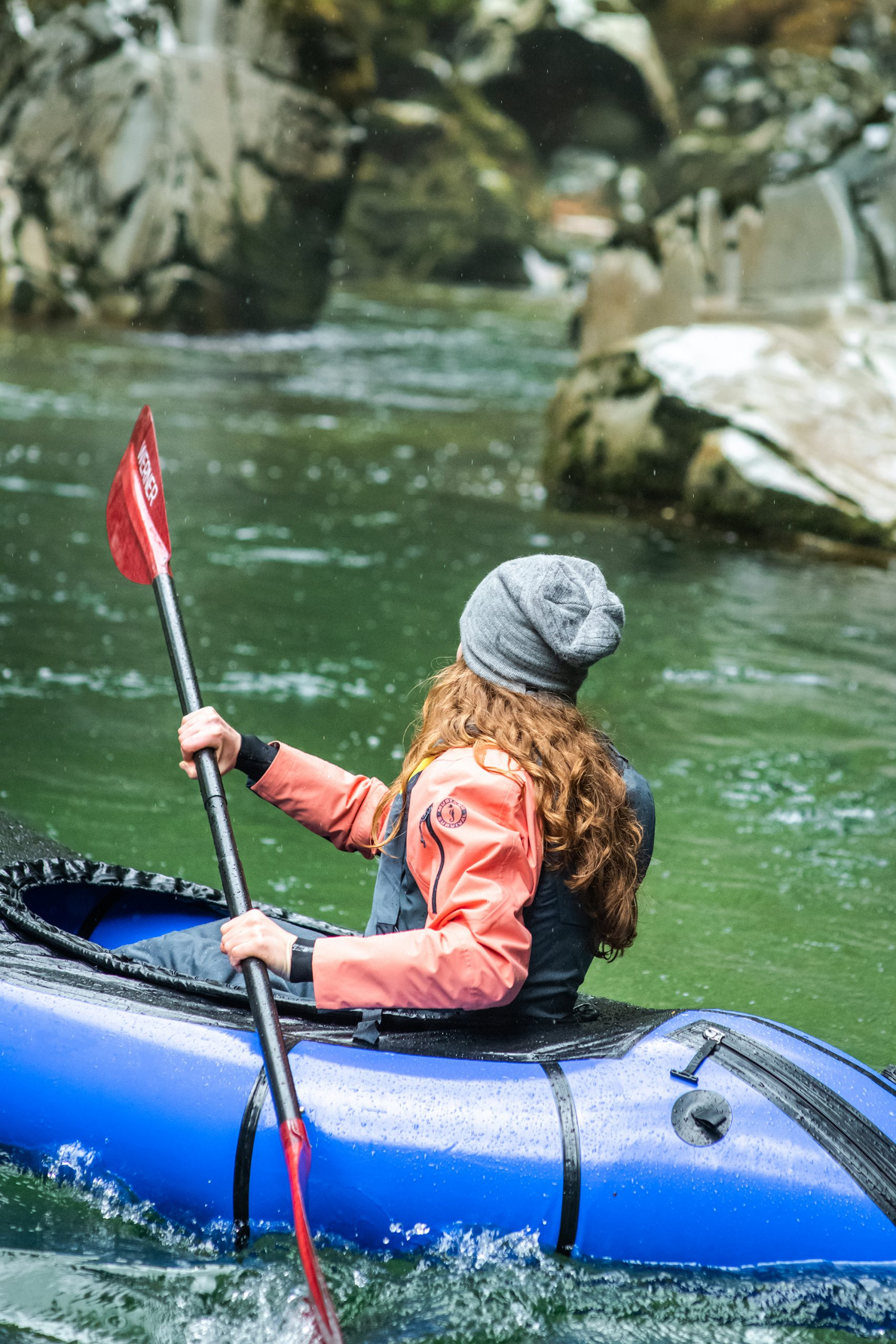 Woman paddling showing Mustang Helix Dry Suit