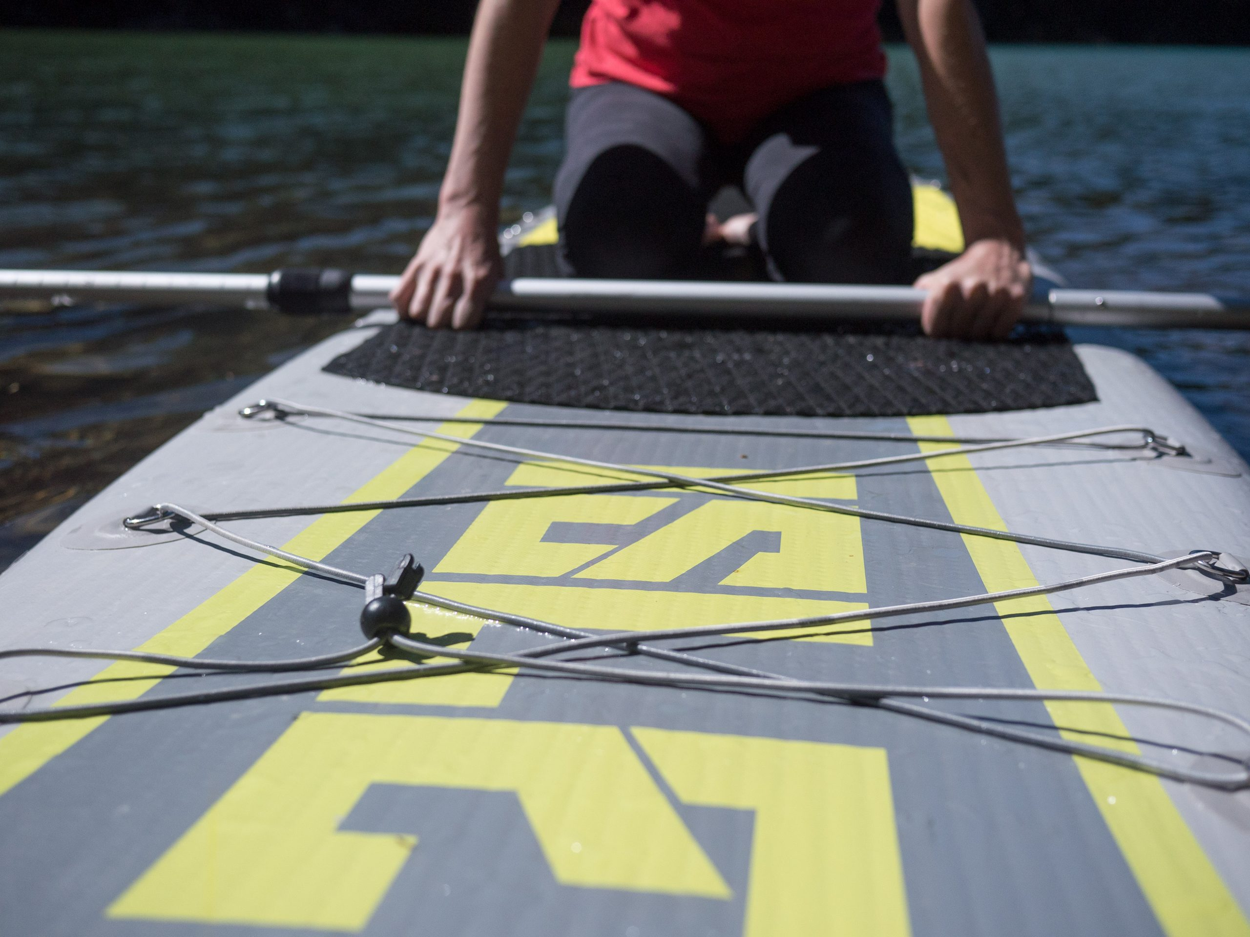 close up mid section of paddleboard